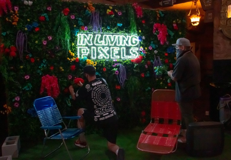"""Local artists gathered in the Aztec theatre to set up and install a pop-up art exhibition, """"In Living Pixels,"""" curated by Wide Awake Creative Studio in Partnership with Pabst Brewing Company and Live Nation."""