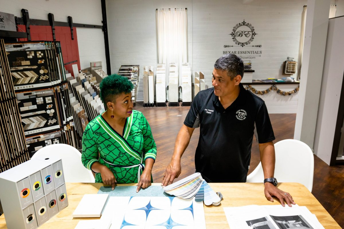 Cerissa Tate, founder of Industrious Interiors, talks to Joe Trinidad Jr., owner of Bexar Essentials Remodeling. Tate works with Trinidad on various interior design projects.