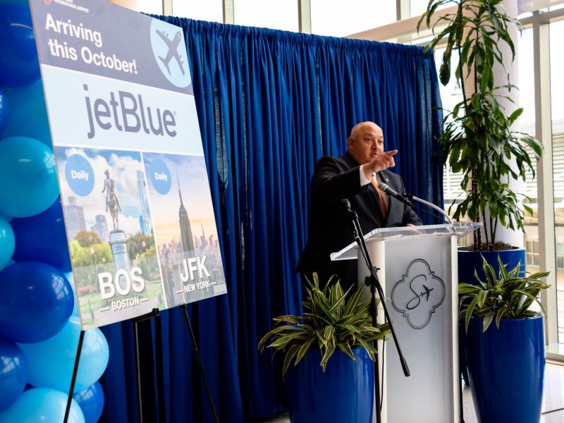 Director of Airports, Jesus Saenz, announces the arrival of JetBlue Airlines at the San Antonio International Airport. Starting this October, the seventh-largest airline in America will offer daily flights to SAT to BOS and JFK.