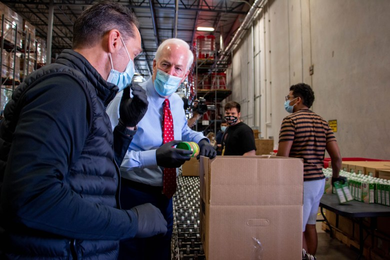 U.S. Senator John Cornyn (R) joins the President and CEO of the San Antonio Food Bank, Eric Cooper, in an assembly line to pack boxes with non-perishable food items for those in need.