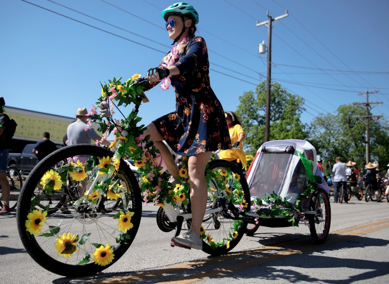 A person rides their flower-themed bike during the inaugural Fiesta Bike Parade on Saturday.