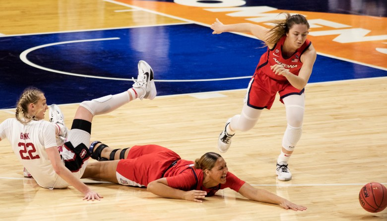 Arizona forward Lauren Ware (32) reaches for a loose ball as Stanford forward Cameron Brink (22) falls during the championship game in the women's Final Four NCAA college basketball tournament on Sunday at the Alamodome. Stanford held off an Arizona comeback to win the title, 54-53.