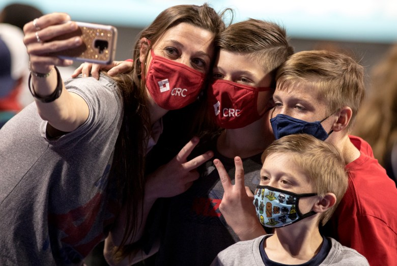 A family of Arizona fans takes a photo during the championship game in the women's Final Four NCAA college basketball tournament between Arizona and Stanford on Sunday at the Alamodome. Stanford held off an Arizona comeback to win the title, 54-53.