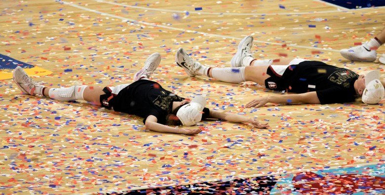 Stanford players celebrate their win over Arizona in the championship game in the women's Final Four NCAA college basketball tournament on Sunday at the Alamodome. Stanford held off an Arizona comeback to win the title, 54-53.