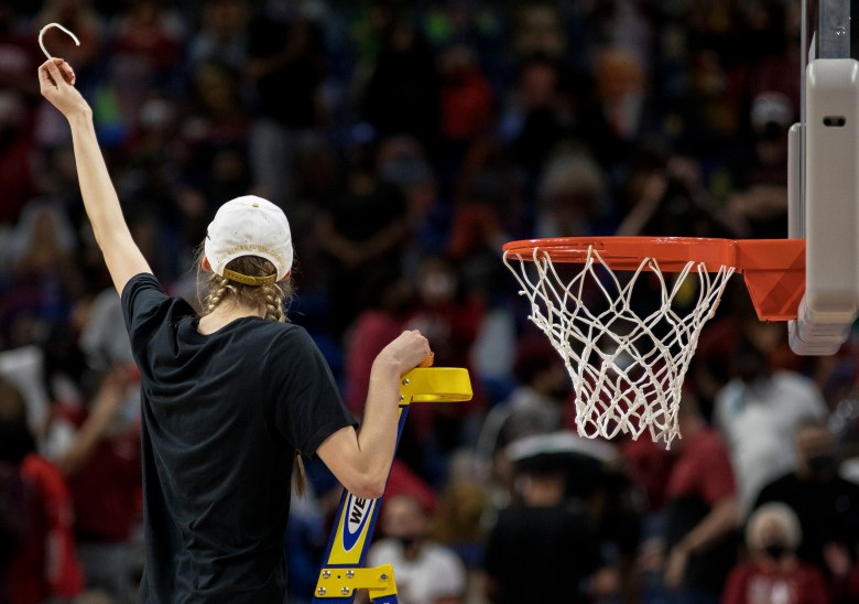 Stanford forward Cameron Brink holds up a piece of the net after defeating Arizona in the championship game in the women's Final Four NCAA college basketball tournament on Sunday at the Alamodome. Stanford held off an Arizona comeback to win the title, 54-53.