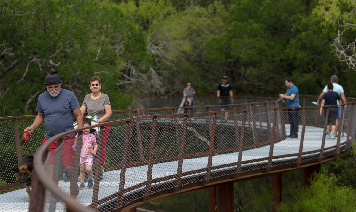 People enjoy the newly-opened skywalk at the Robert L.B. Tobin Land Bridge at Phil Hardberger Park on Monday. The 1,000-foot-long skywalk cost $23 million and was funded through both donations and the 2017-2022 bond package