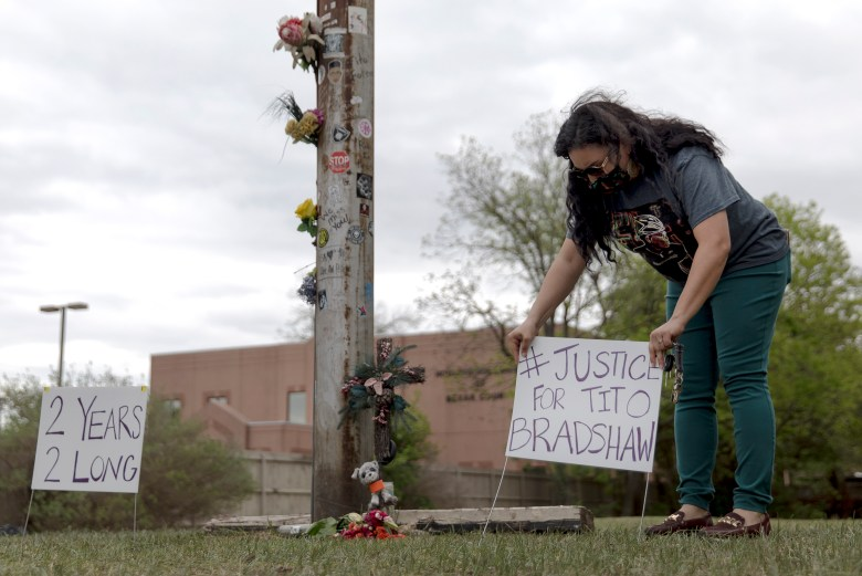 Jennifer Peña pushes a sign into the ground during an event honoring bicyclist Tito Bradshaw on Saturday. Bradshaw, a beloved local cyclist, was struck and killed by an alleged drunk driver on April 1, 2019, on East Houston Street. Family members and friends gathered to demand justice for Tito and urge city officials to approve a bike-safe infrastructure plan.