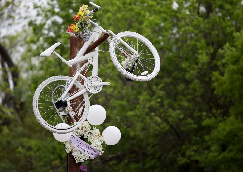 A memorial to beloved local bicyclist Tito Bradshaw is seen on Saturday. Bradshaw was struck and killed by an alleged drunk driver on April 1, 2019, on East Houston Street. Family members and friends gathered at his memorial to demand justice for Tito and urge city officials to approve a bike-safe infrastructure plan.