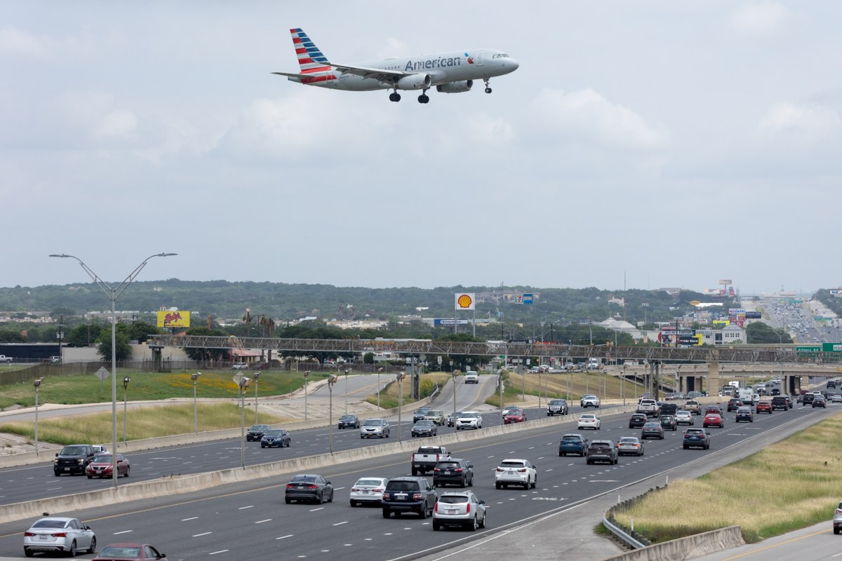 An American Airlines jet approaches the San Antonio International Airport runway over Highway 281 on Wednesday.