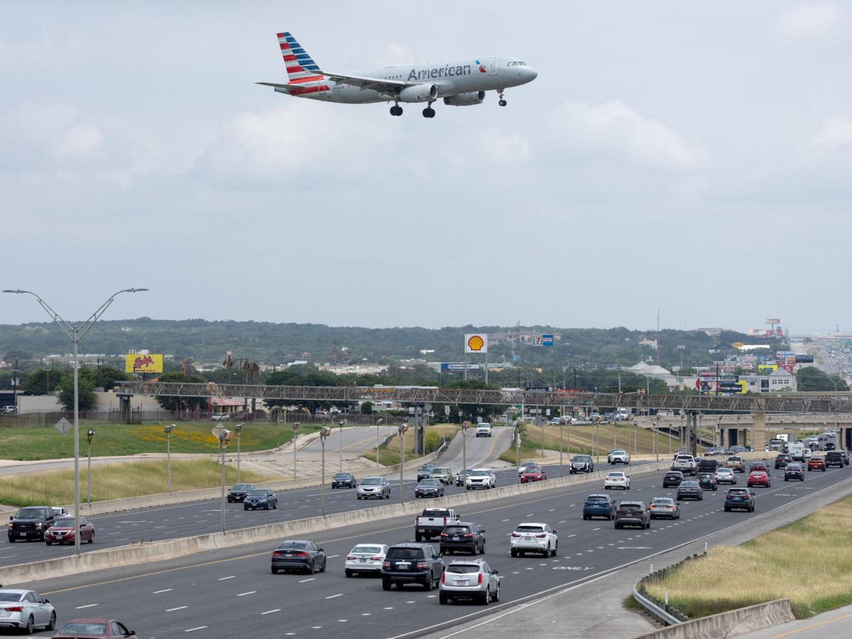 An American Airlines jet approaches San Antonio International Airport over U.S. Highway 281.