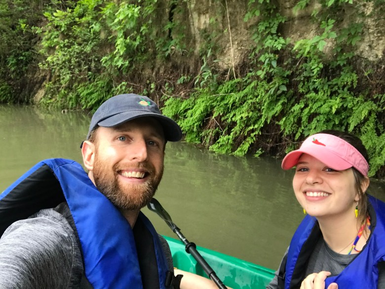 Brendan Gibbons and Jessica Mrozinski pause near a fern bank on the Guadalupe River.