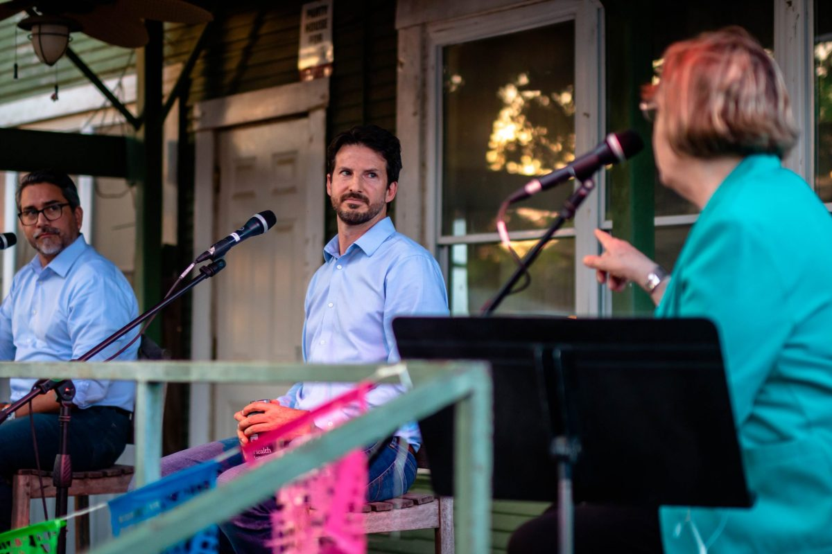 Mario Bravo (center) will face Councilman Roberto Treviño (left) in the District 1 City Council runoff on June 5.
