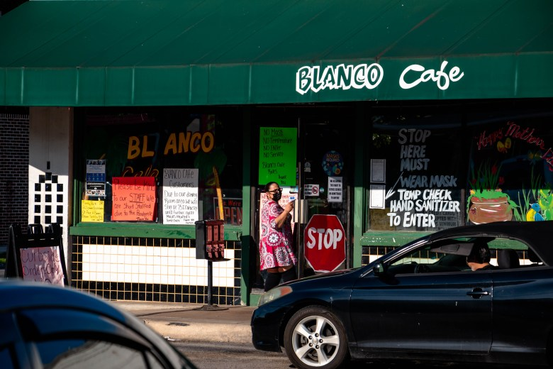 A waitress takes a curbside order out to a car parked in front of Blanco Cafe. This Mexican cafe is not be confused with the original Blacno Cafe on N St. Mary's street.