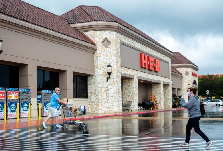 A customer exits the HEB in Lincoln Heights without a mask as another customer walks towards the entrance with a mask. The CDC announced this week that vaccinated individuals can visit indoor and outdoor spaces without a mask.
