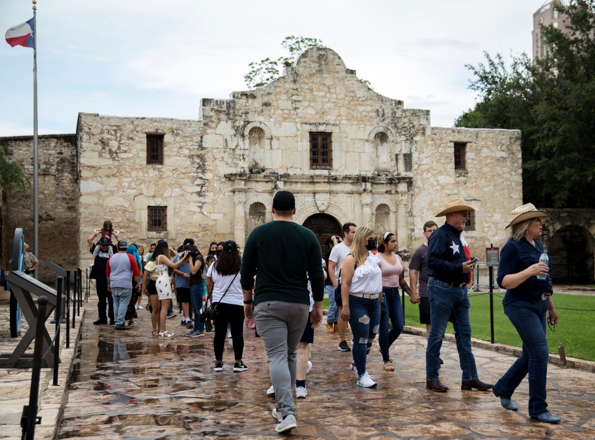 Tourists visit the Alamo on Memorial Day.