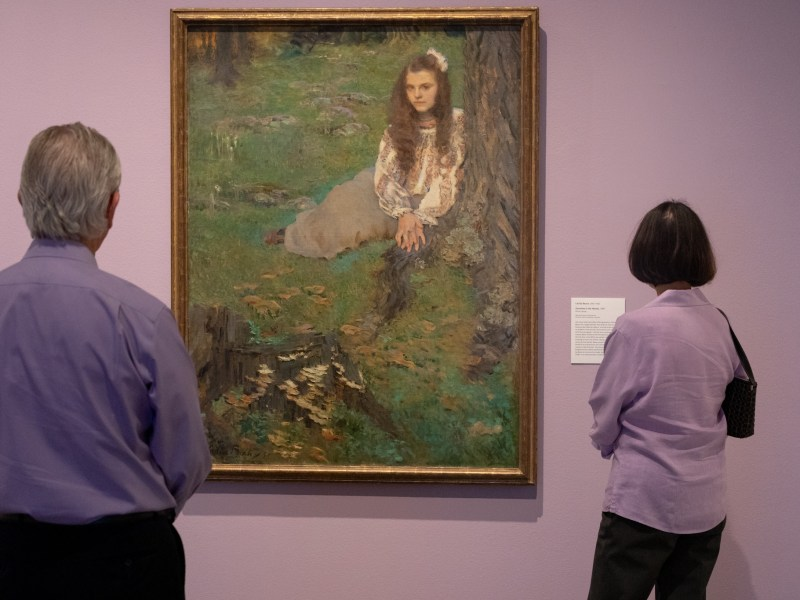 Guests of the San Antonio Art Museum observe Cecilia Beaux', Dorothea in the Woods, the first piece presented in the exhibition America's Impressionism: Echoes of a Revolution.
