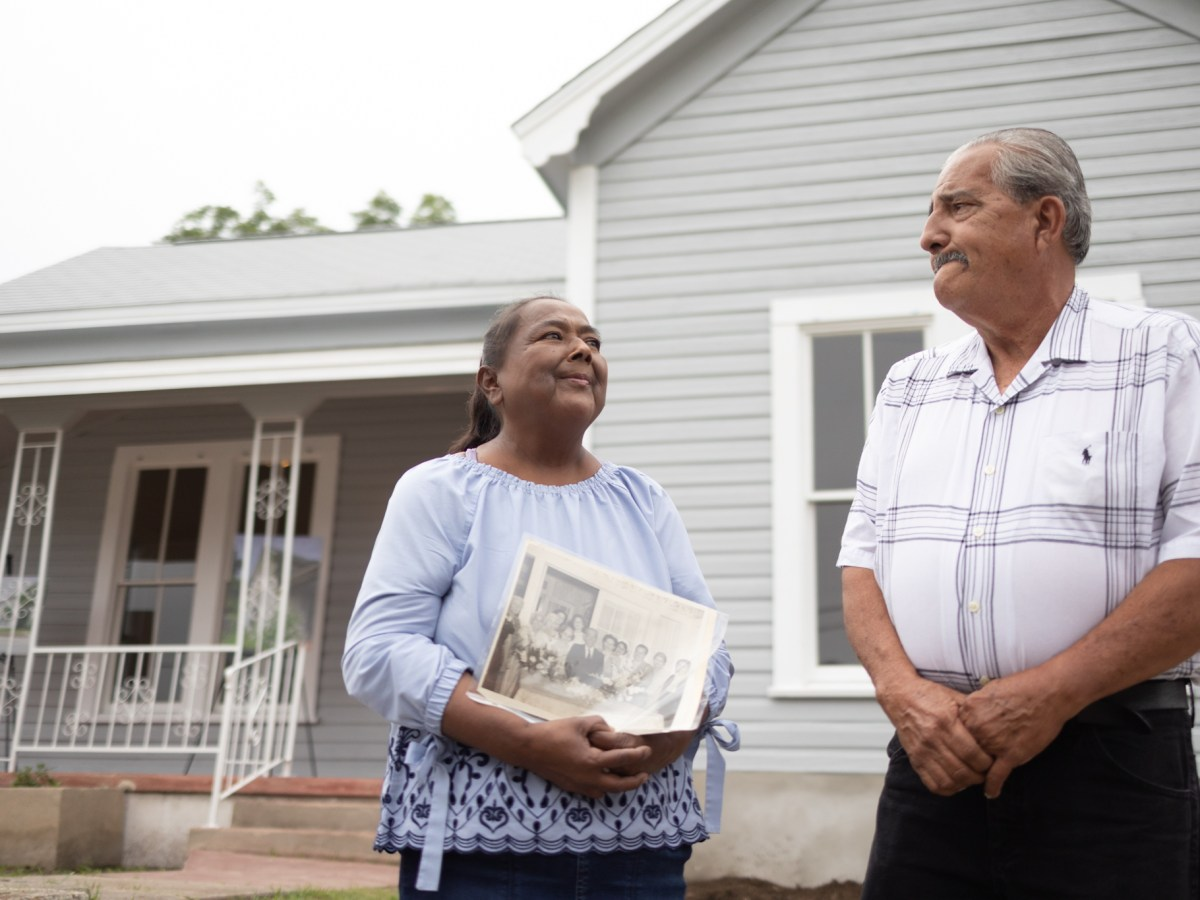 Homeowners Laura and Humberto Martinez stand in front of their rehabilitated home which was renovated through the District 5 Shotgun House Renovation Pilot Program.