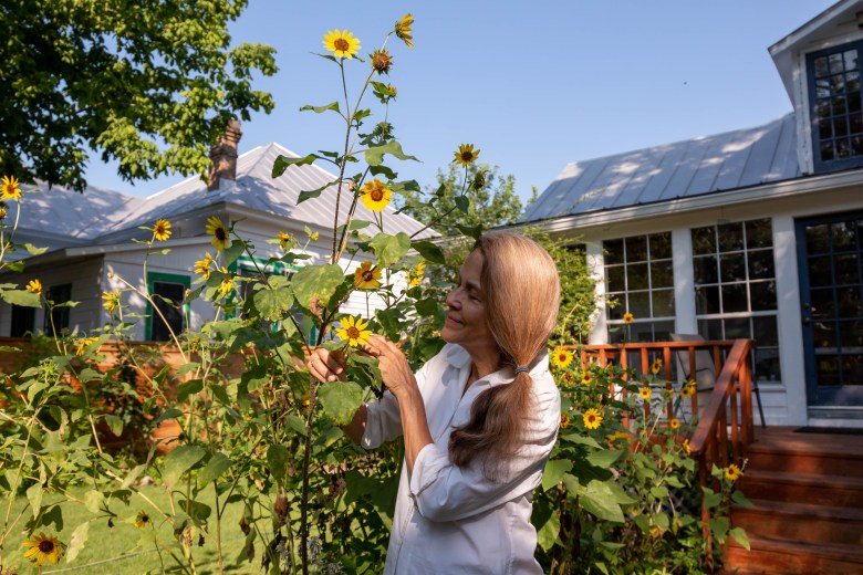 Nye enjoys the sunflowers her son planted in their backyard garden.