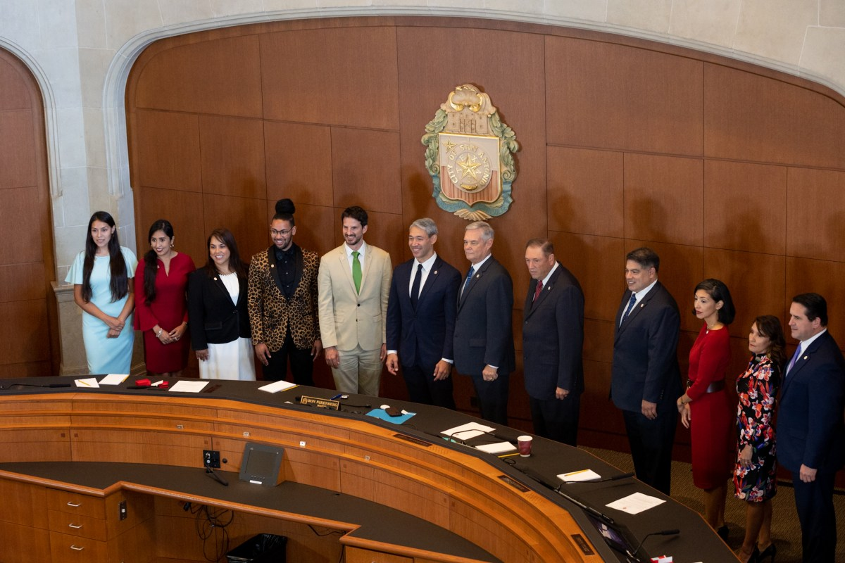 The newly formed City Council along with City Manager Erik Walks (right) takes a an official photograph at the Municipal Plaza Chambers.