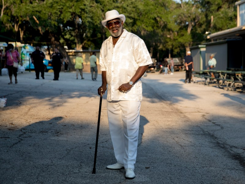 """""""Black"""" Mike Henderson poses for a portrait during the Juneteenth Festival at Comanche Park on Friday."""
