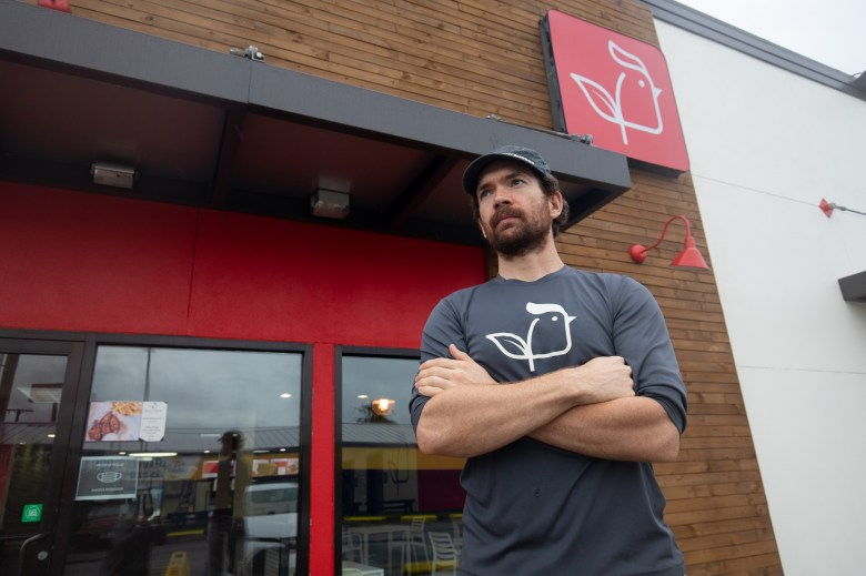 Lucas Bradbury, owner of Project Pollo stands outside his fast-food chain location at San Pedro near downtown.