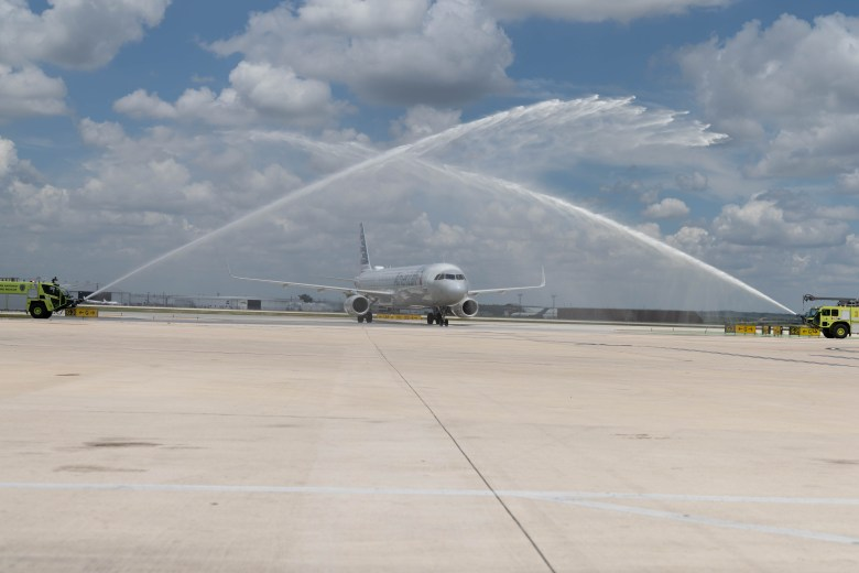 Two SAFD firetrucks perform a water cannon salute over American Airlines flight 1967 which is carrying the remains of Marine PFC JL Hancock. Family of the fallen Marine requested that his remains be returned to San Antonio for burial at Fort Sam Houston.