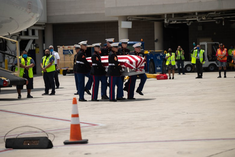 U.S. Marines carry the casket holding the remains of fallen Marine PFC JL Hancock from commercial American Airlines flight 1967 to the hearse. Hancock's body had been undiscovered in a small pacific island for 77 years following a battle against the Japanese in 1943.