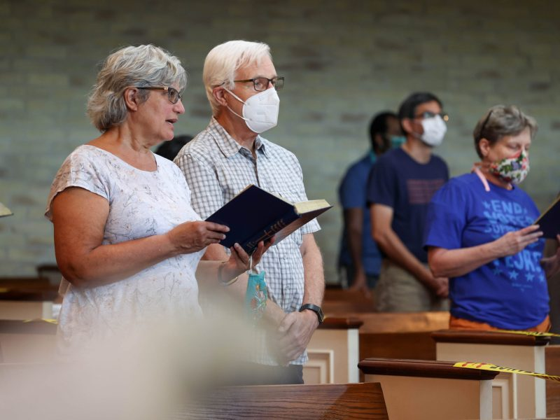 Attendees of the Voting Rights Vigil sing a hymnn at Friendship Baptise Church Saturday.