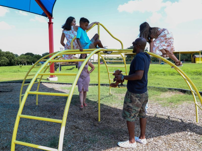 Wendy and Craig Ball play with their three children, Ava, Adrianna, and Solomon at the Converse City Park Thursday.