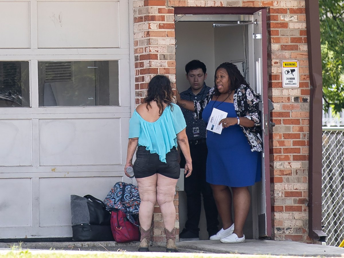 A staff member at City Council member Mario Bravo's District 1 field office speaks to a homeless woman on Wednesday.