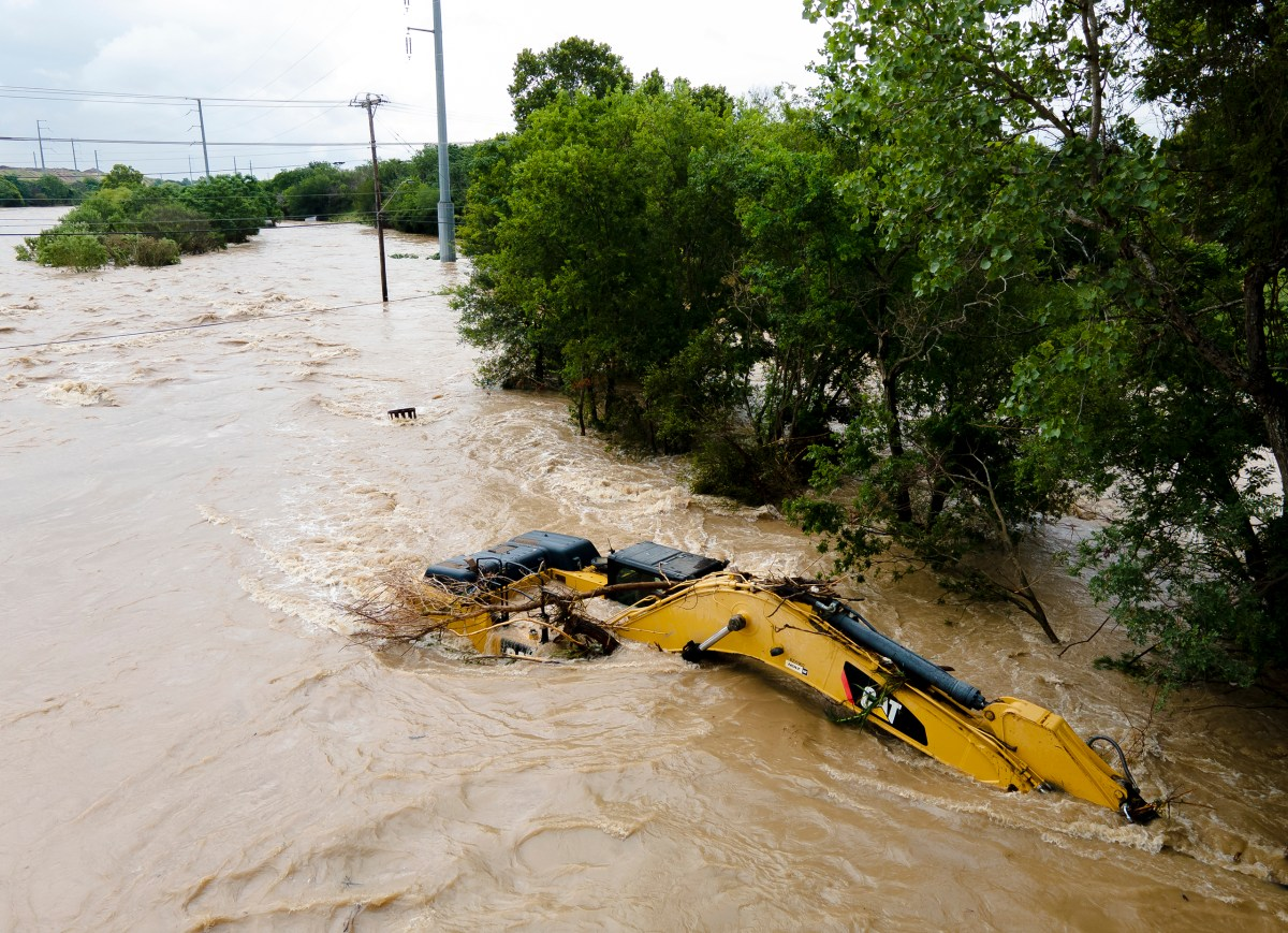 An excavator sits in Leon Creek floodwaters on Tuesday.