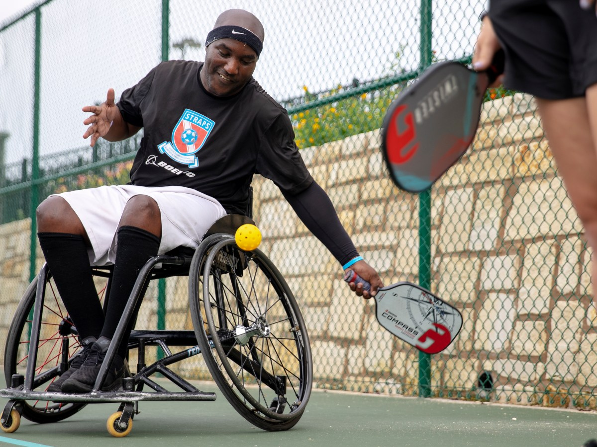 Mario Wright serves the ball while playing pickleball at Morgan's Wonderland Sports complex on Thursday.
