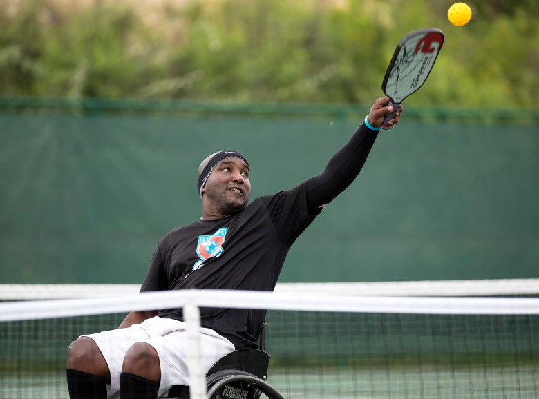 Mario Wright hits the ball while playing pickleball at Morgan's Wonderland Sports complex on Thursday.