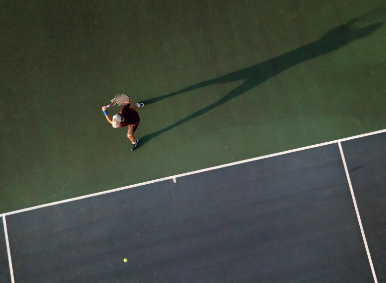 Marcus Torres prepares to backhand the ball while practicing tennis with Zach Frisbie at Clark High School on Sunday.