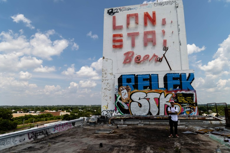 Photographer Larry Martinez stands on the roof of the Lonestar Brewery.
