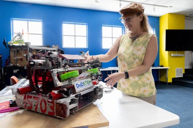 Mary Garr interacts with one of the robots in the Teen Tech Room at Family Service where children can come and learn about various STEAM subjects.