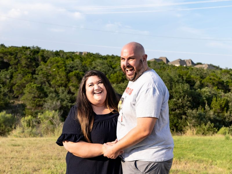Cherise and Lucas Moreno laugh in the front yard of their Creekaven home. They have lived in this neighborhood since 2018.