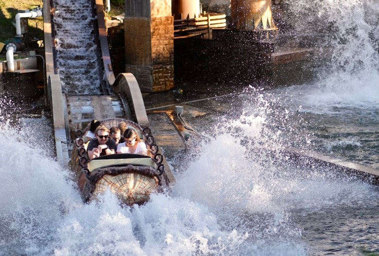 People ride the Bugs' White Water Rapids attraction at Six Flags Fiesta Texas on Saturday. The theme park was forced to cancel its popular Celebrity Fan Fest event due to a new surge of COVID-19 cases caused by the Delta variant.