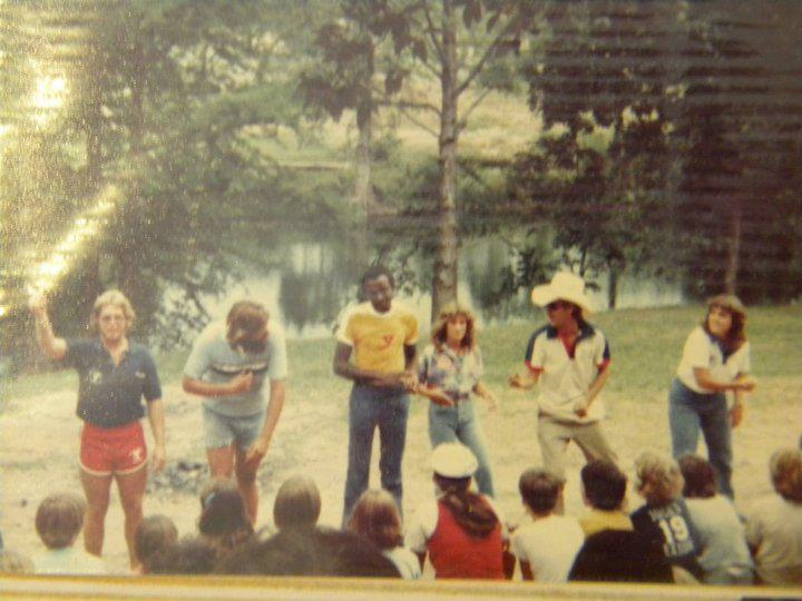 Campers dance and sing at the amphitheatre in front of the Guadalupe River at Camp Flaming Arrow.