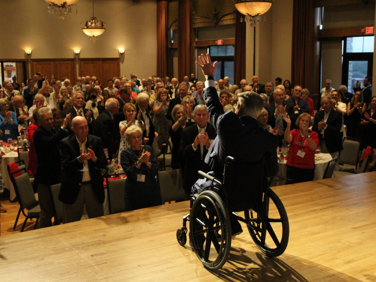 Gov. Greg Abbott speaks to a maskless crowd in Collin County on Monday, a day before he tested positive for the coronavirus.