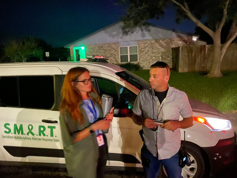 Samantha Gabriel and Bexar County Deputy Brett Retherford discuss a call they responded to as part of the Specialized Multidisciplinary Alternate Response Team, or SMART.
