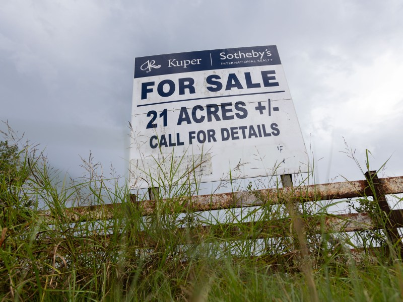 Ranch land for sale in Bergheim is advertised along Texas State Highway 46.