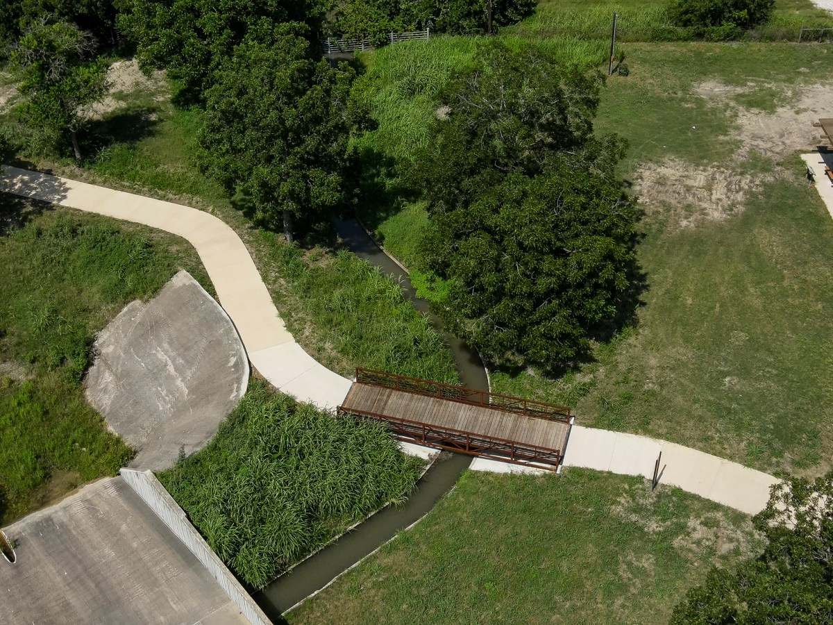 A trellis bridge, shaded picnic area, and the San Juan Acequia are all featured throughout a new 1,200-foot linking trail in South San Antonio that connects Greenline Park to the Mission Reach.