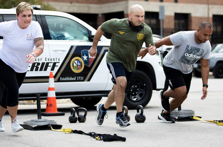 Sheriff Javier Salazar participates in a fitness exam during a recruitment event hosted by the Bexar County sheriff's office on Saturday.