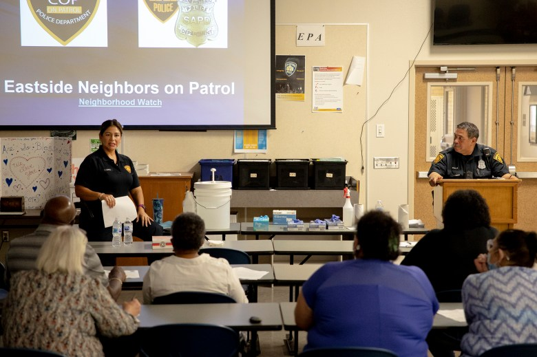 San Antonio police officer Tina Cortez, left, speaks to community members during a neighborhood watch class on Wednesday.
