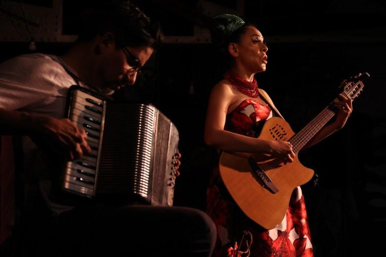Azul Barrientos sings corridos accompanied by Jaime Ramirez on the accordion.