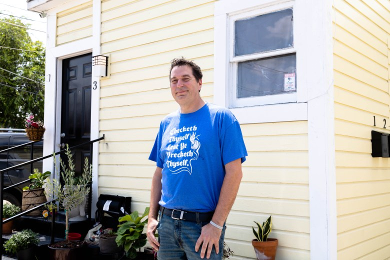 David Fisher poses in front of one of his properties on Howard Street Tuesday.