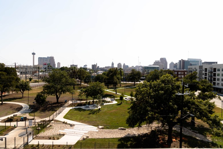 The downtown skyline is visible from the skylounge at the top of Herrera's apartment complex.