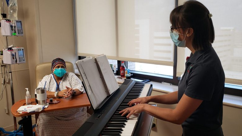 Carmen Lopez Regalado listens to music performed by Constanza Roeder at Methodist Hospital.