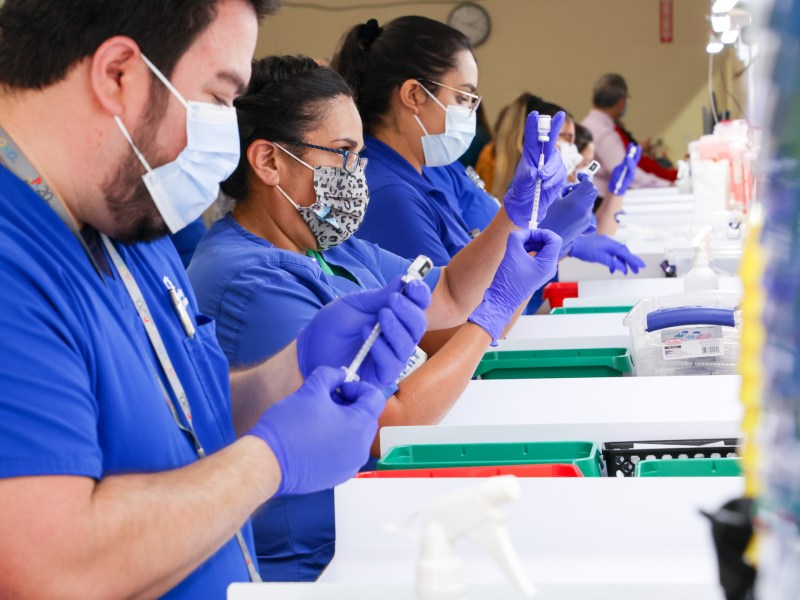 University Health pharmacy technicians pre-dose syringes of the Pfizer vaccine against COVID-19 at Wonderland of the America's on Friday, September 24th, 2021.